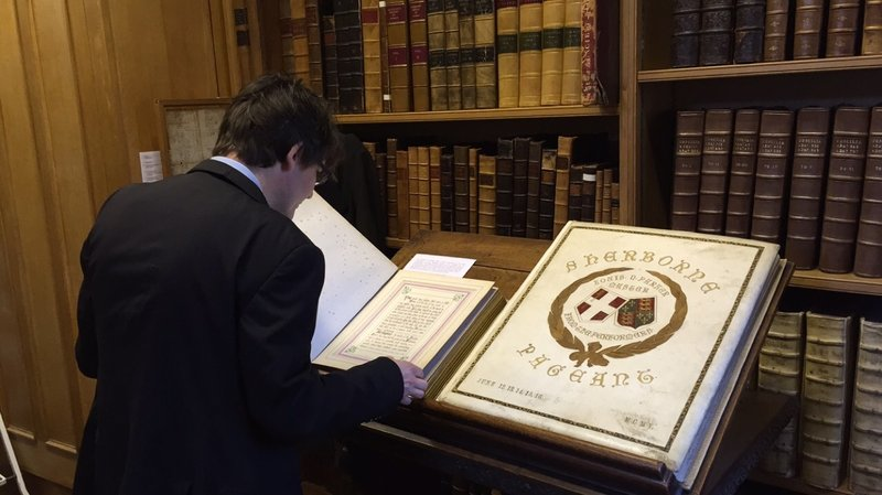 Paul inspects archival material in the Sherborne School Archive